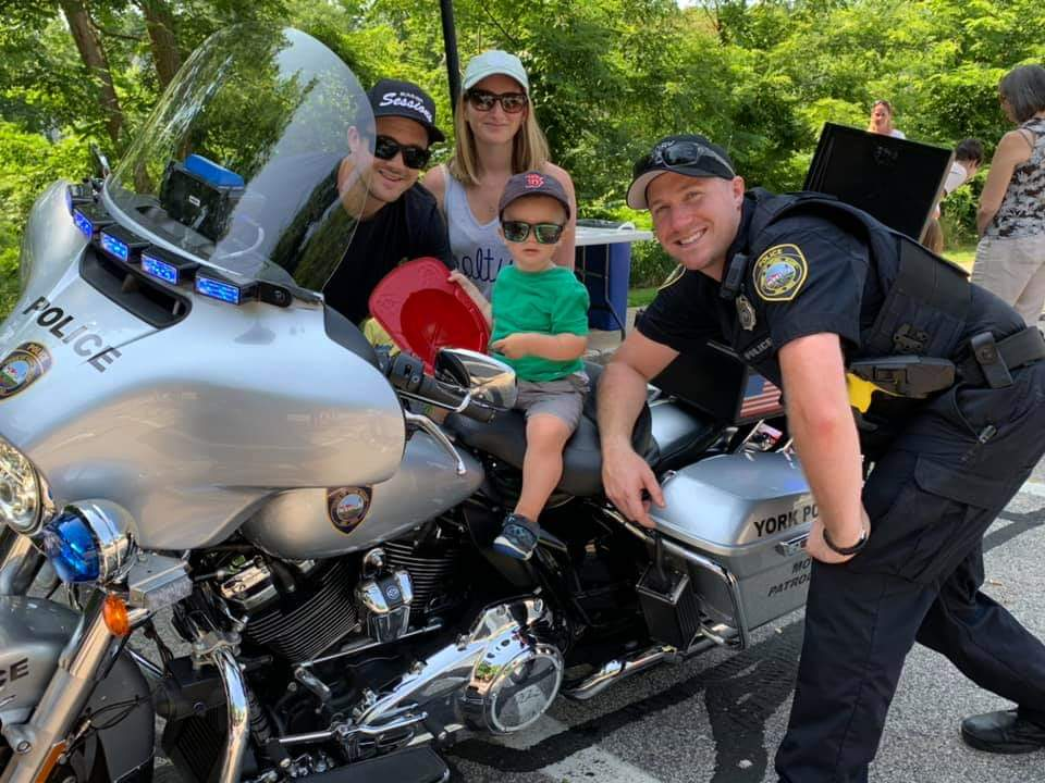 Officer McKinnon with children on morotcycle